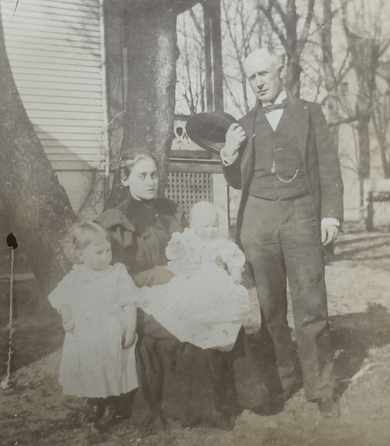 Judge Stafford and his family beside the Francis Barnes House